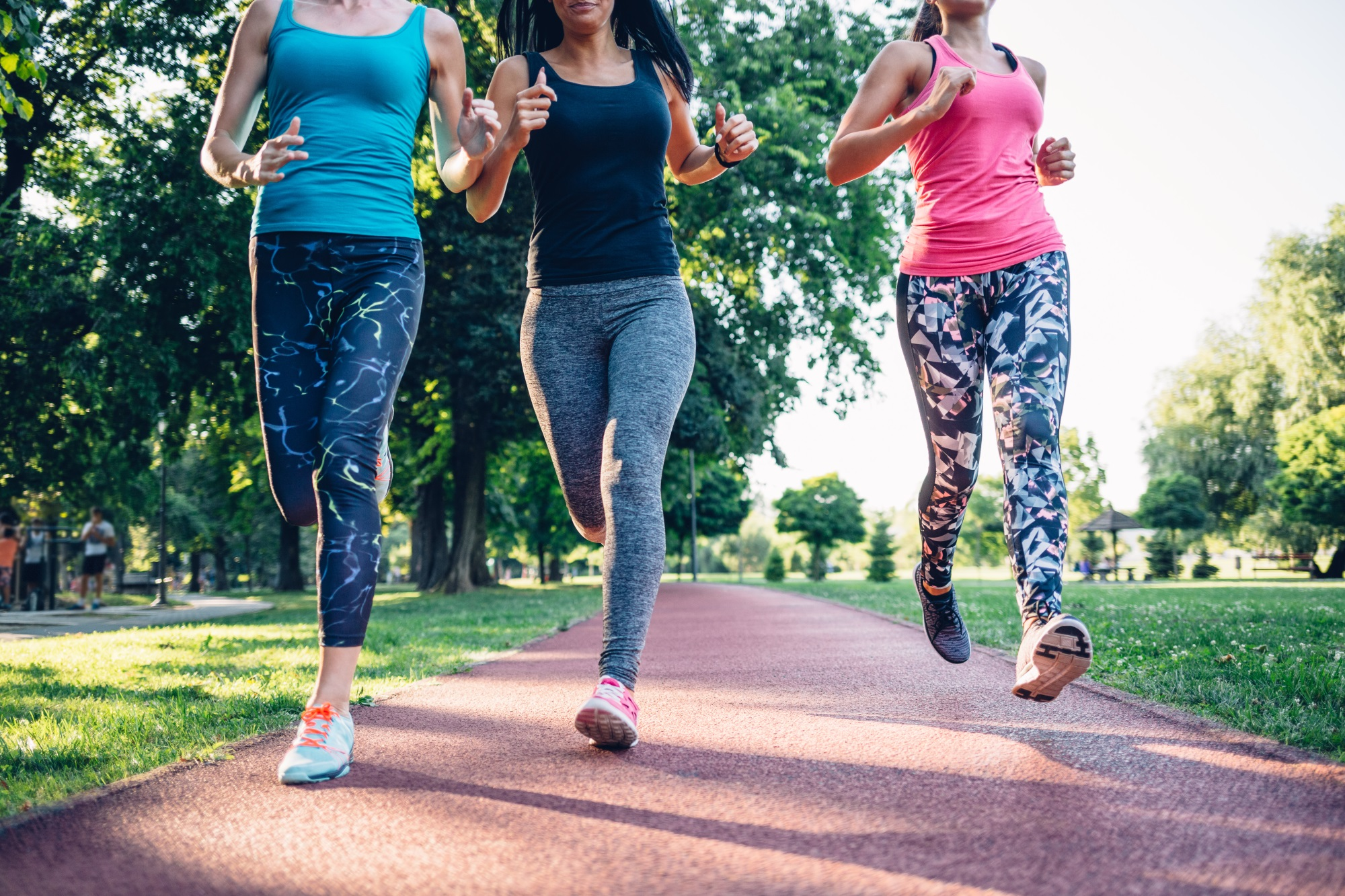 A women's running group jogging in the park