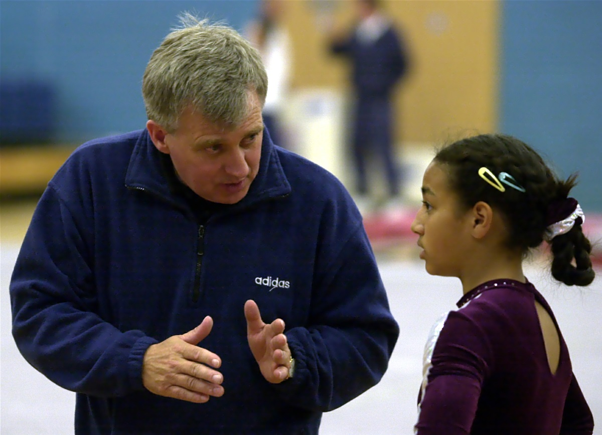 A coach communicates verbally with his athlete
