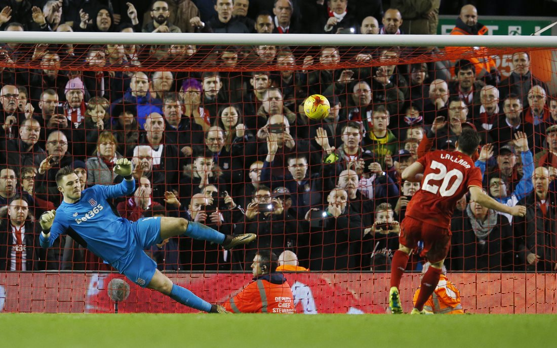 Stoke and England Goalkeeper Jack Butland faces a penalty from Adam Lallana in the Capital One Cup Semi Final Second Leg