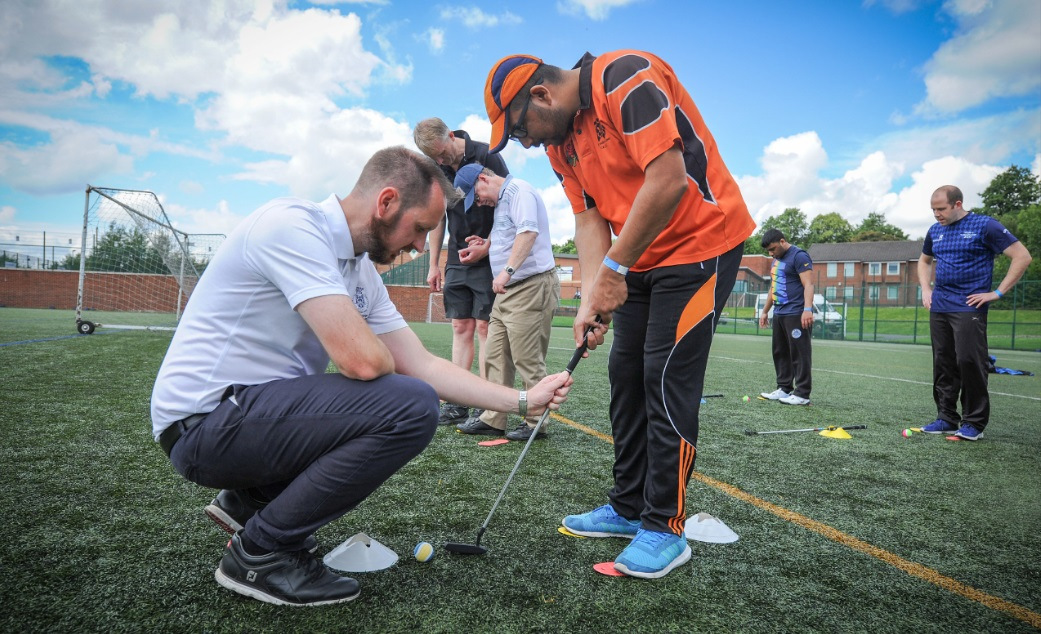 A blind golfer learns the art of putting