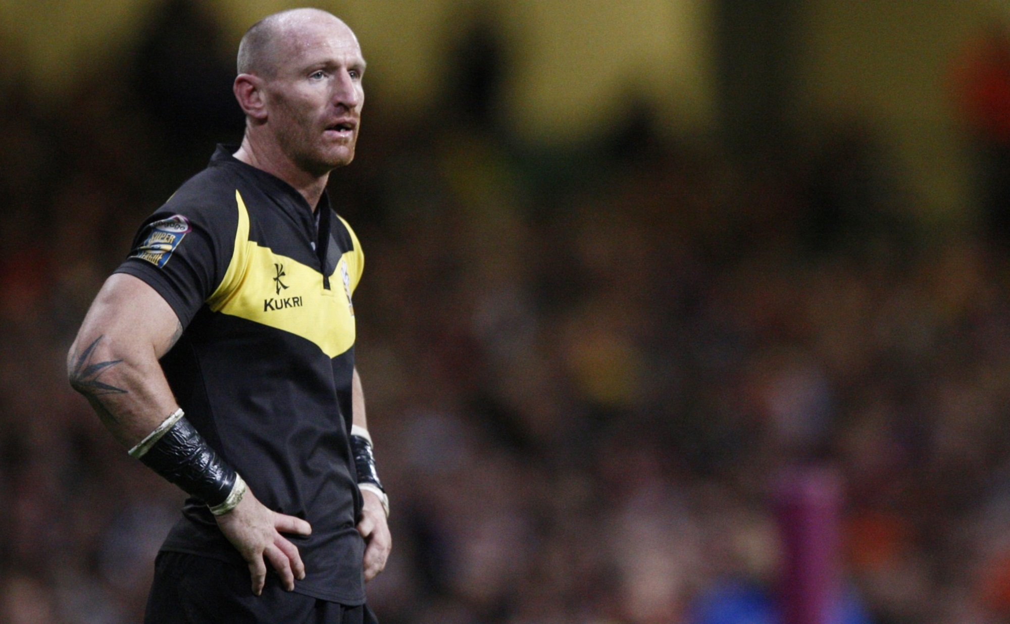 Gareth Thomas stands hands on hips during a break in the action