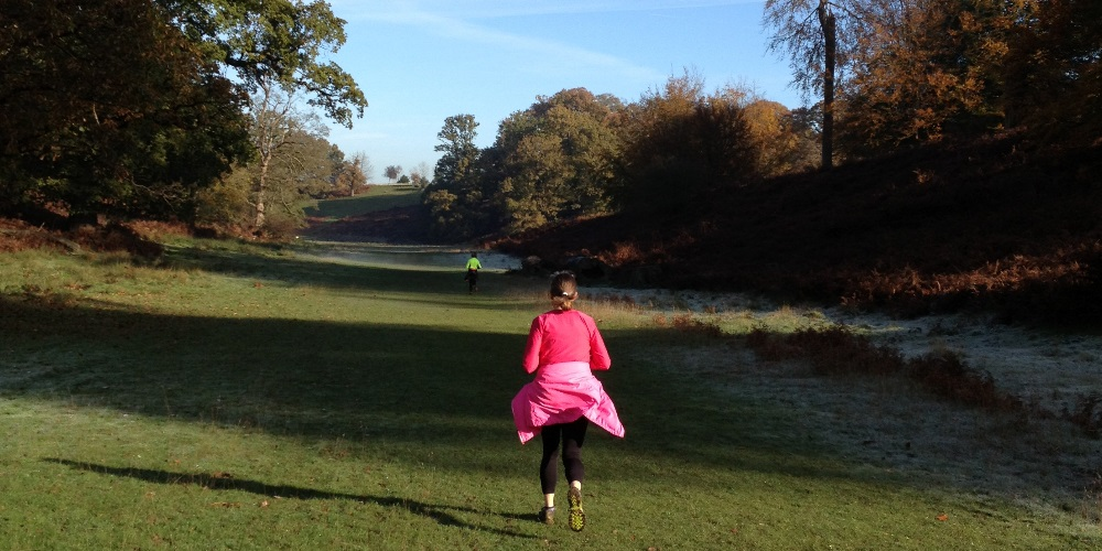 Two women jogging through Knowle Park