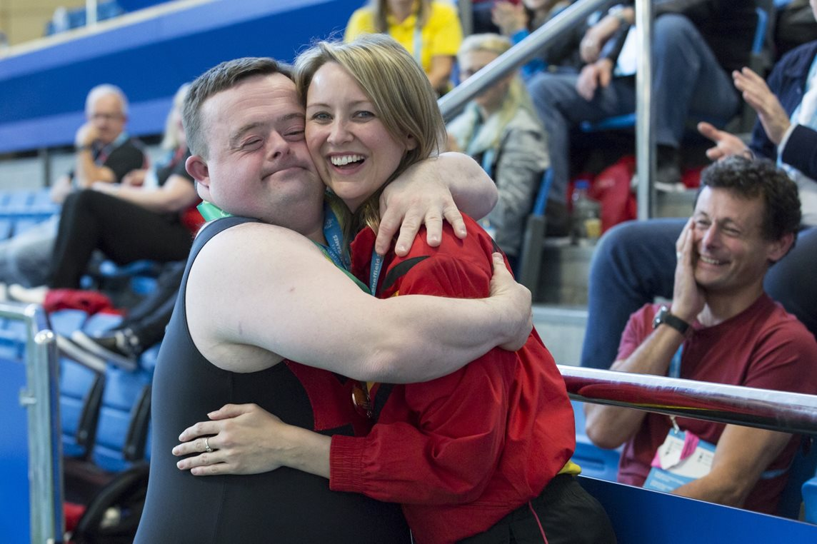 A gymnast competing in the UK Special Olympics in Sheffield gives a special hug to their coach
