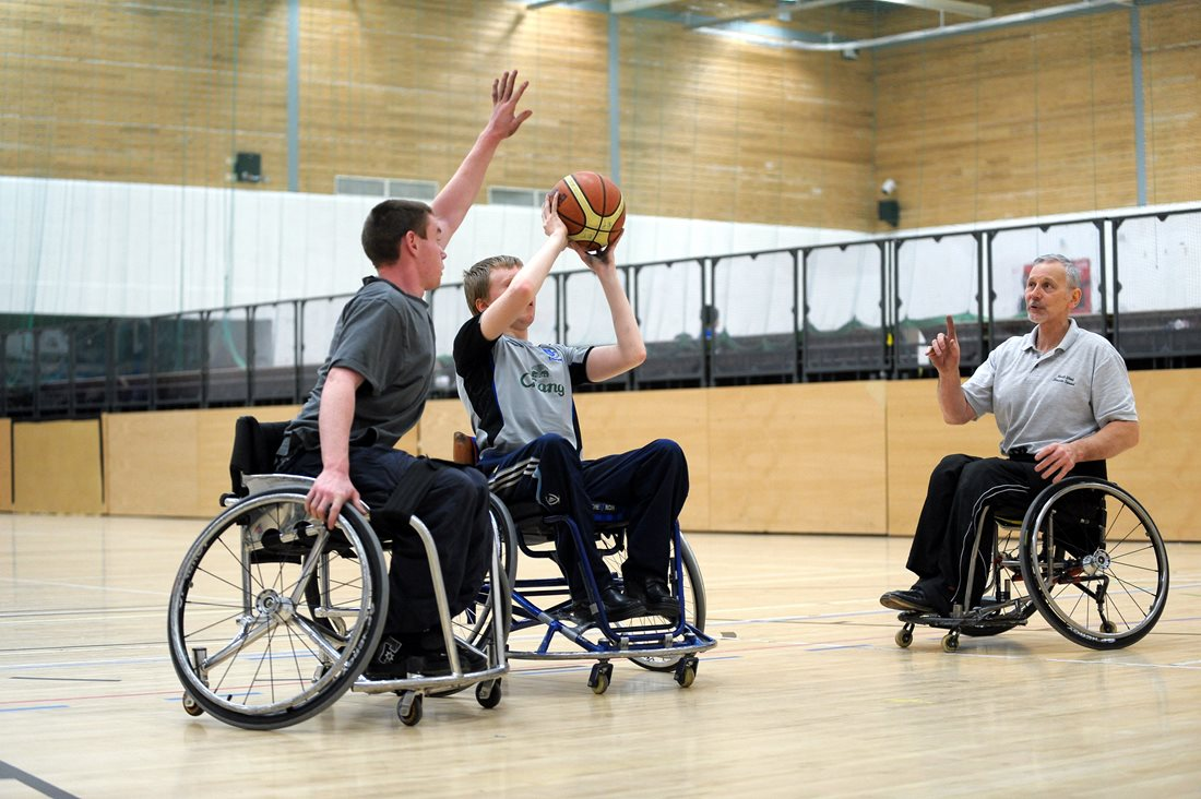 Wheelchair basketball player taking a shot