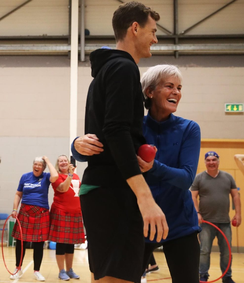 Judy Murray and her son Jamie share a fun moment with a class of participants